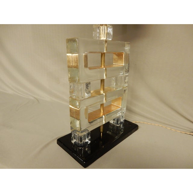 """Pair of modern Italian heavy lucite lamps with black painted base and gold leaf in inside sides of lucite. 18"""" H from..."""