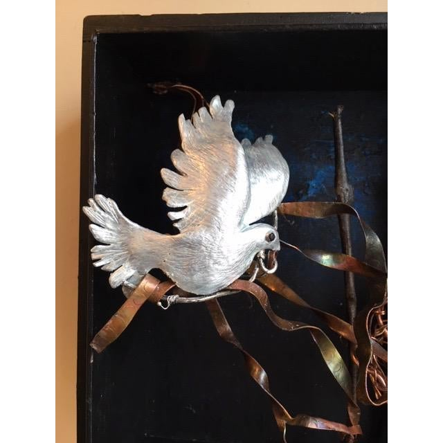 The sculpture is in a shadow box. The dove is a hand carved out of wax and then cast in bronze. The dove has a pearlized...