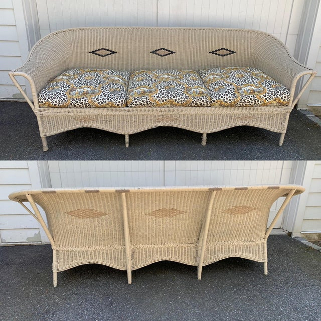 Lovely vintage wicker sofa set beautifully upholstered in a cheetah patterened fabric. Set includes a three seat sofa,...