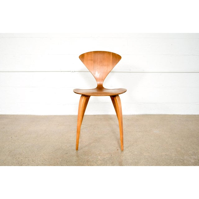This vintage mid century modern molded plywood side chair was designed by Norman Cherner for Plycraft in 1958. The iconic...