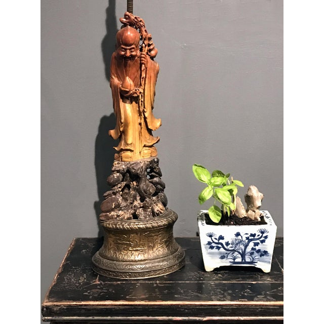 Up for sale is an unusual finely carved antique Chinese Shoushan soapstone (寿山石) figure of standing God of Longevity...