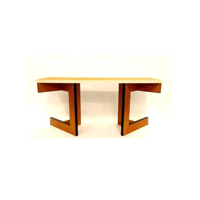 Constructivist console table designed by Eric Freeman. Table can also serve as a writing desk. An ingenious design...