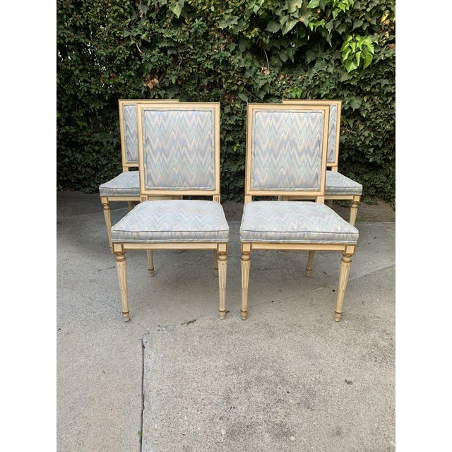 A Luxurious set of 4 dining chairs. Beige with Gold wood contrast color, with lovely light blue color fabric upholstery,...