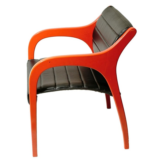 A pair of chairs bent red lacquer wood with black leather upholstery by Claudio Salocchi for Sormani ca. 1960s
