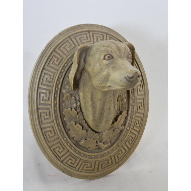 Wooden hand-carved ornamental dog head in the middle of the 20th century. This decorative dog head carving technique uses...
