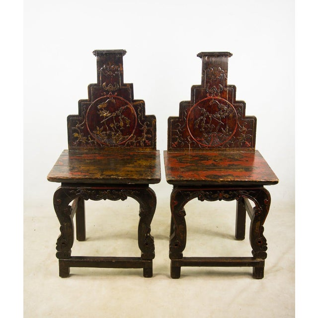 These Chinese traditional hall chairs show the perfect amount of distressing to the original lacquer finish and carvings....