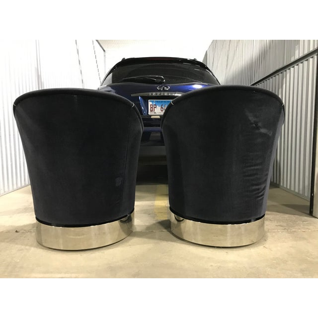 A pair of modern style Marina barrel chairs designed by Sally Sirkin for J. Robt. Scott. The upholstery is Black plush...