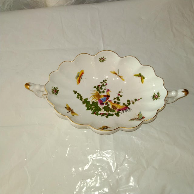 Fabulous centerpiece bowl by Limoges. Birds, butterflies galore. Bowl with double handles. Exquisite and tres chic!