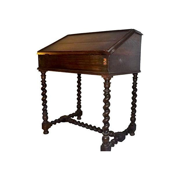 English oak desk on stand with drop lid, circa 1710. Features turned barley-twist legs and stretchers. Desk case includes...