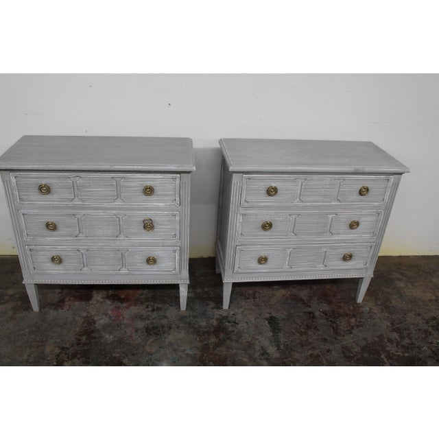 Vintage Gustavian style nightstands made of solid oak wood and feature three spacious drawers and tapered block legs....