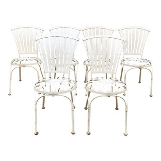 A set of six vintage Carre style spring steel chairs