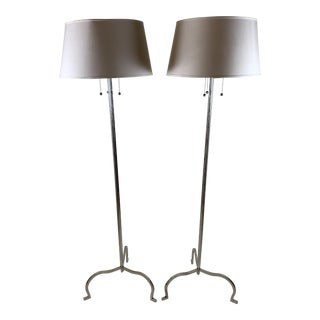 Chromed Iron Floor Lamps in the Style of Tommi Parzinger - a Pair For Sale