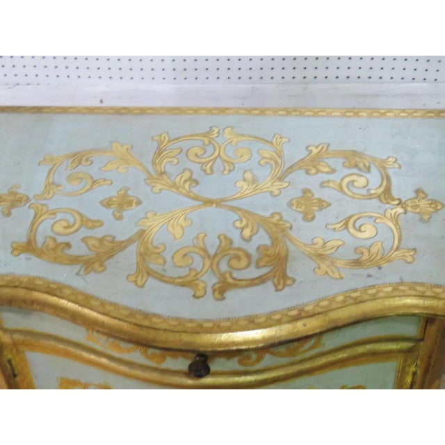 Antique Louis XV style distressed painted side table with 1 drawer over 2 doors and gilt accents.