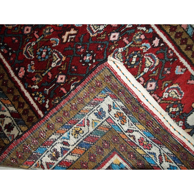Vintage Persian Iranian Hamadan wool runner in good original condition, Circa 1970. This rug is very typical for the...
