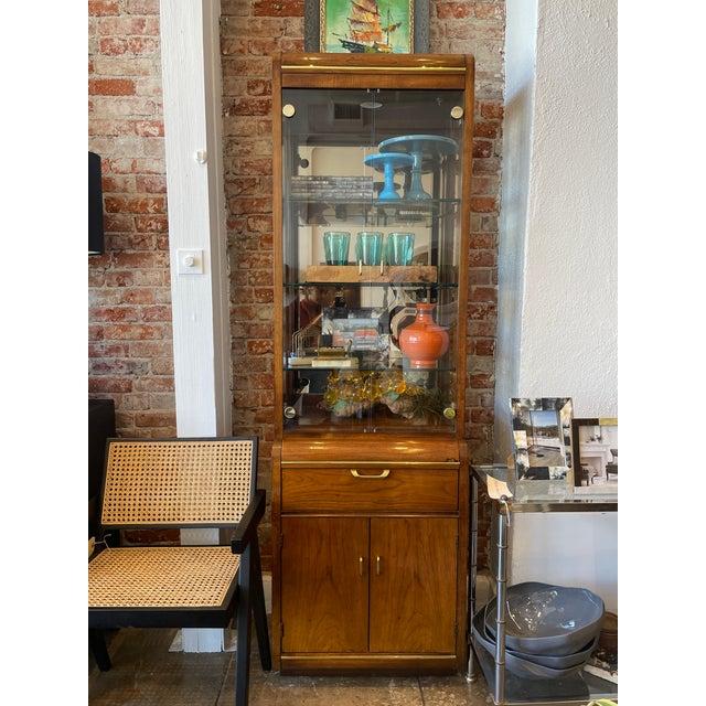 Vintage Thomasville narrow display cabinet with original brass hardware. Upper cabinet includes 3 original glass shelves...
