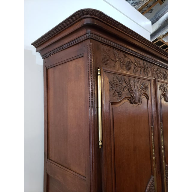 This grand Louis XV Period French Provencal Armoire has large brass hinges and escutcheons, and lots of carving details....