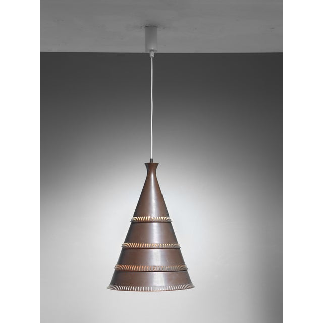 A cone-shaped brown copper model p208 pendant lamp by Knud Hjerting for Lyfa. We can adjust the total drop to your...
