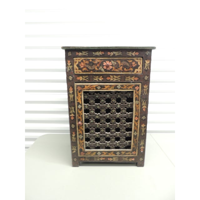Handpainted vintage Indian night stand Pierced wood details on front door Wood handles Finished in all three sides...