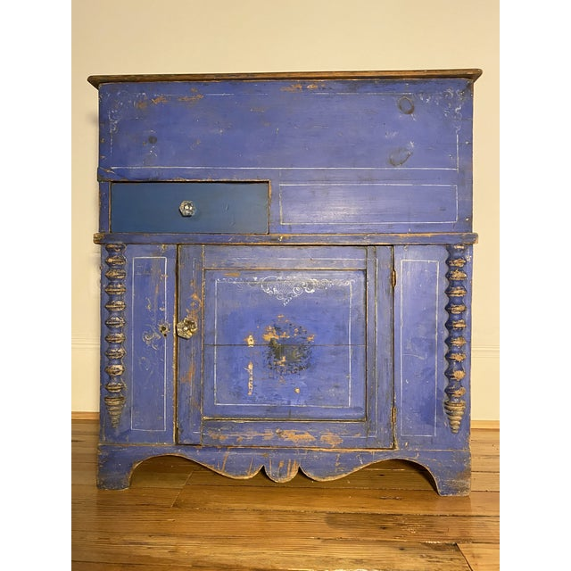 Special enough to design a room around-Mid 19th century commode with original bright blue paint, half spool turned detail,...