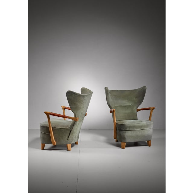 A pair of very rare and spectacular Finnish wingback lounge chairs from the late 1940s, attributed to Runar Engblom. The...
