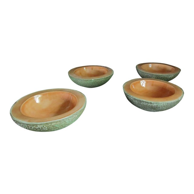 Here's a stunning set of four ceramic cantaloupe bowls; each appearing to be half of cantaloupe. The bowls have a great...