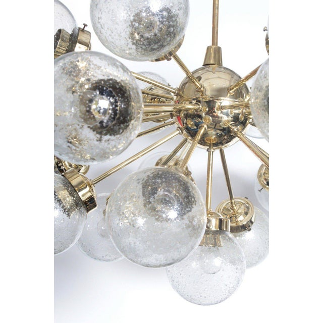 Amazing large-scale brass Sputnik chandelier with 25 glass globes by Doria. Stem can be cut to size. Chandelier body...