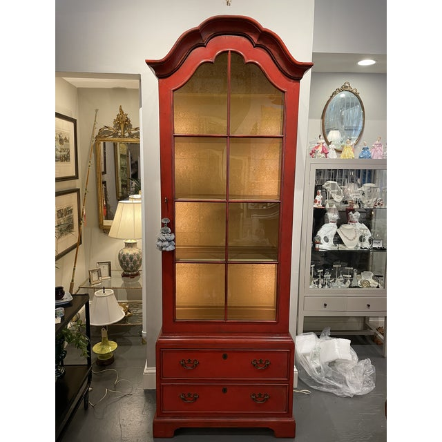 This is a gorgeous Asian Style Curio Cabinet. It is a beautiful red color with a decorative gold patterned inside. There...