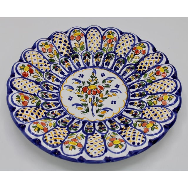 Bright and cheerful, country French style ceramic plate with scalloped edging, hand-painted and signed by Spanish artist....
