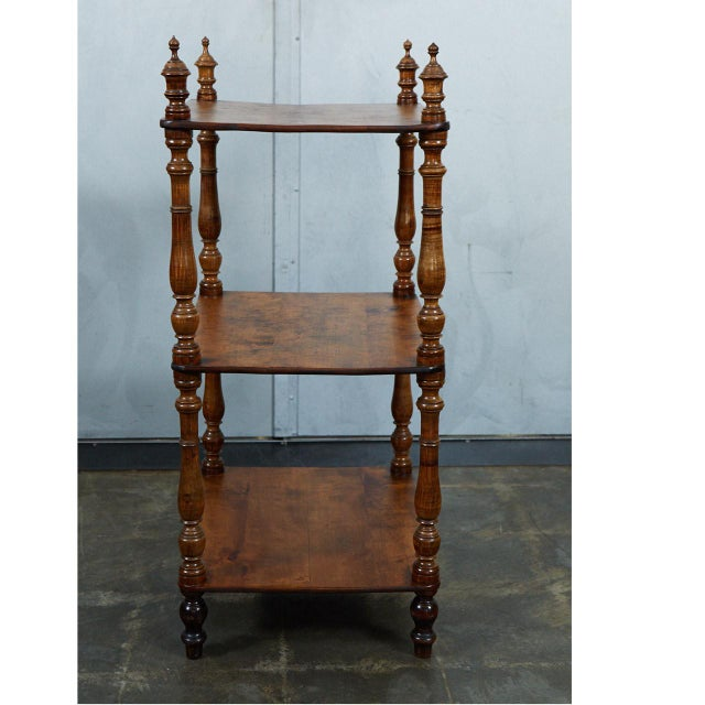 This english what not has two shelves and turned elements. The structure is made up of beautifully turned pieces...