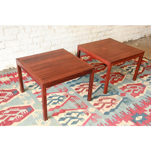 Offering a gorgeous pair of mid-century Danish Modern rosewood coffee or end tables designed by Henning Kjærnulf for Vejle...
