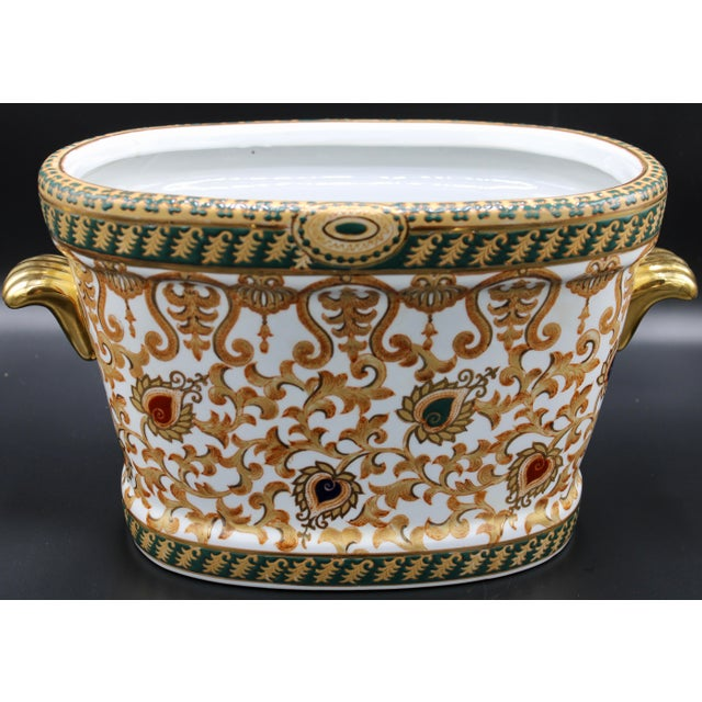 A stellar vintage oriental foot bath. With gold and black enameled paint, and koi fish interior, this vintage Chinese foot...