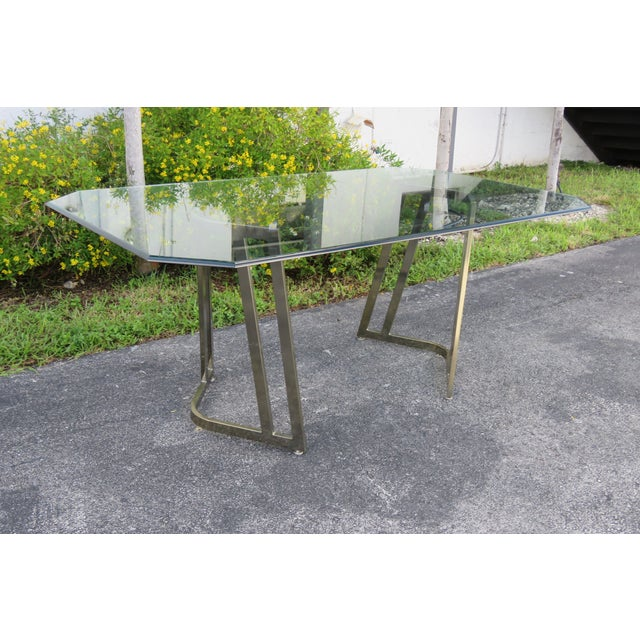 This Set of Dining Table and Six Chairs is made of metal, glass, fabric, and it is in good condition. The set has a...