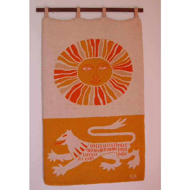 Eye catching Sun & Lion hand hooked tapestry by Evelyn Ackerman. An exceptional hand made wall hanging!