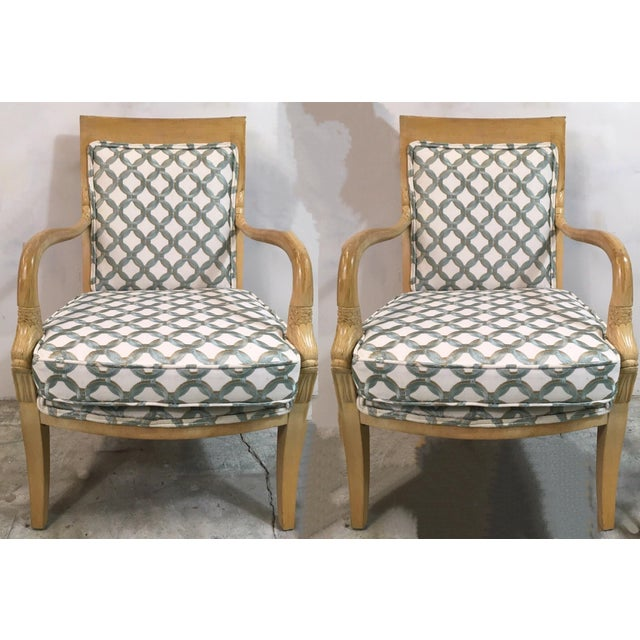 """Pair of carved koi fish arm chairs with new embroidered inter-locking circle upholstery. Arm; 25.5"""". Seat; 18"""". There is..."""