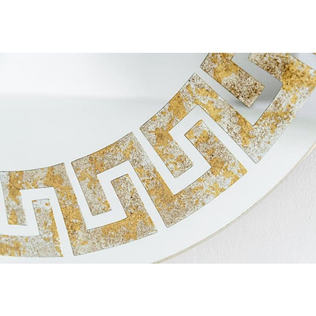 David Marshall signed mirror with reverse gilt Greek key detail. Each segment of the Greek key design is reverse gilt with...
