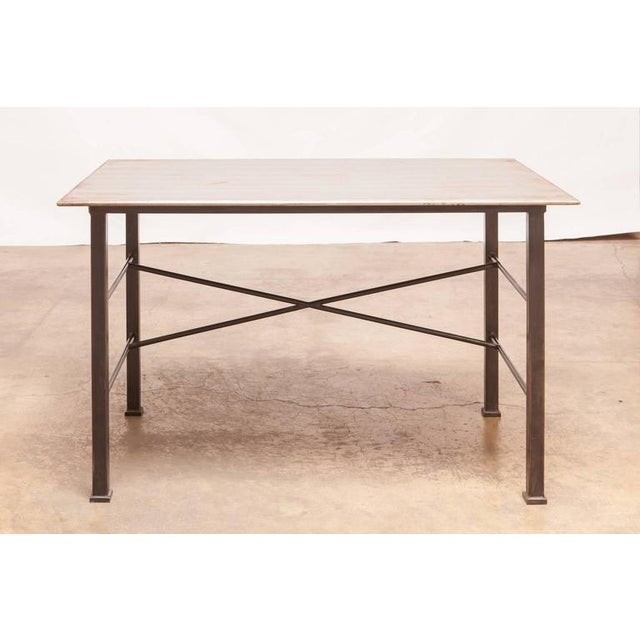 Fine modern Industrial desk constructed of steel featuring a patinated rectangular top supported by large square legs and...
