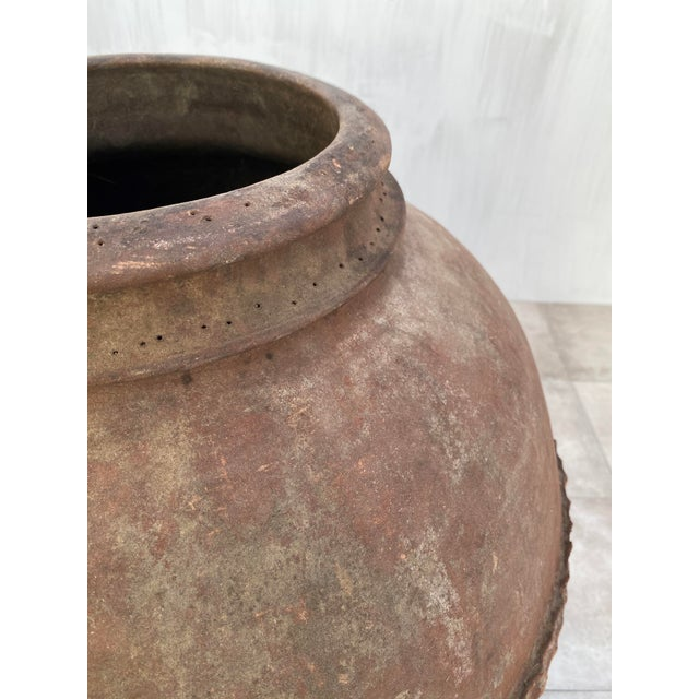An antique terracotta vessel from Salamanca. This piece was built by hand without a potter's wheel using a traditional...