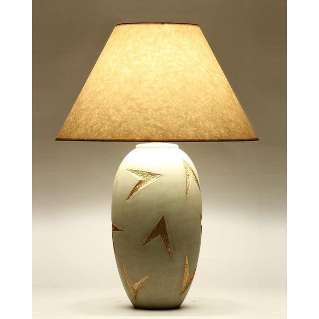 """A golden ambrosia finish ceramic table lamp with natural parchment shade made in the US Shade dimensions: 9""""x22""""x12.5"""""""