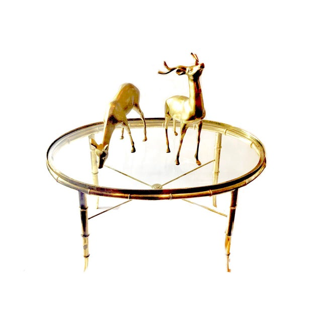 Stunning cocktail table for your Hollywood Regency decor or place your favorite 'brass menagerie' on top. A lot of design...