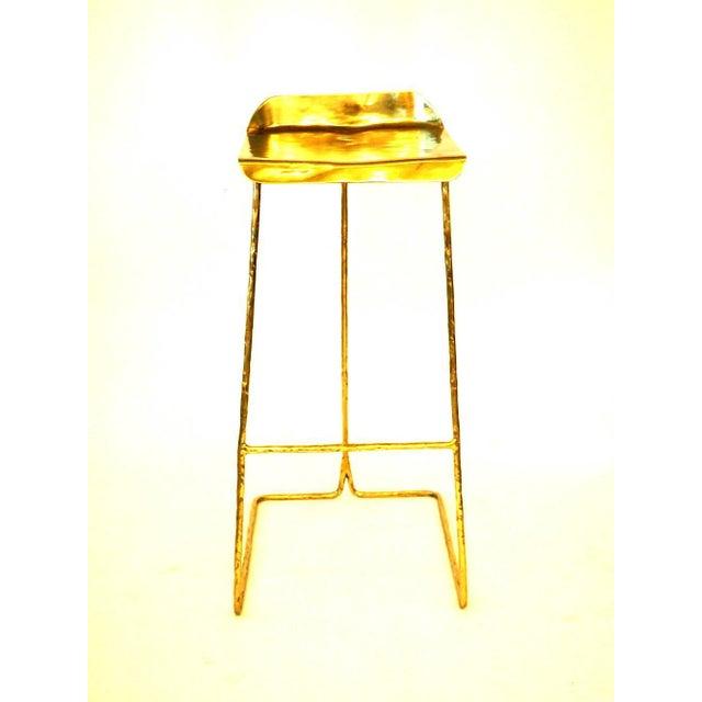 Brass stool, Misaya Dimensions: W 41 x L 51 x H 80/86 cm Hand-sculpted This brass stool won several design awards....