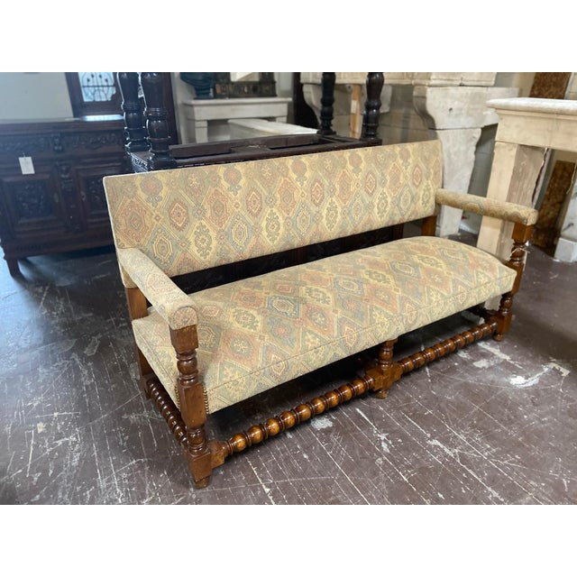 """This bench originates from France circa 1890s. Upholstery in excellent condition and pastel in coloring. Measurements: 26""""..."""