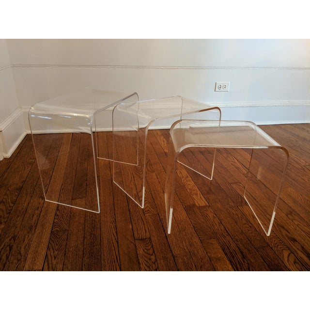 Excellent set of 70's minimalist modern clear acrylic Lucite waterfall style nesting tables. Great vintage set that is in...
