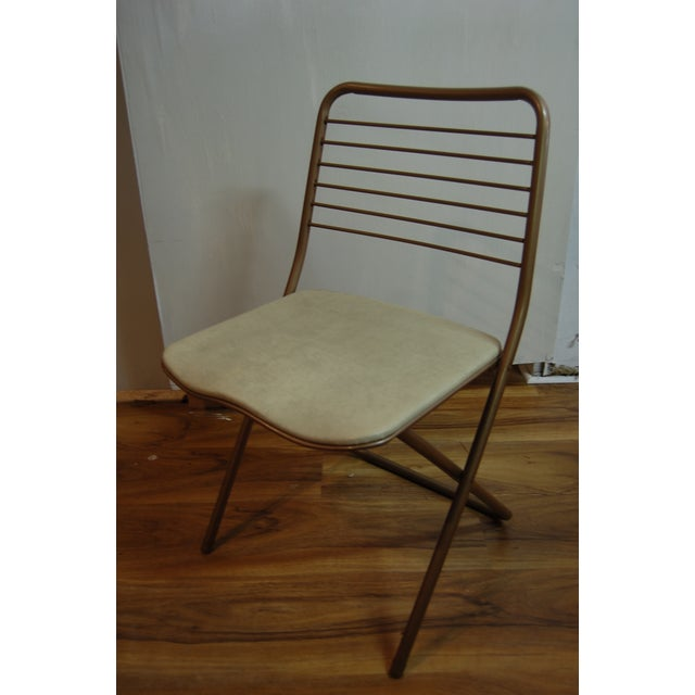 Add a bit a style to your folding chairs with this set of four (4) metal folding chairs from Stylaire. Vinyl Seats, and...