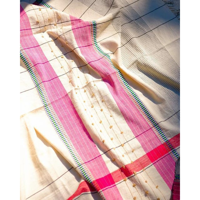Handcrafted from heirloom organic cotton grown in Gujarat, India, the throws are handwoven in one running piece on...