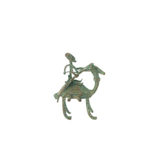 Vintage African Oxidized Copper Person Riding Animal For Sale
