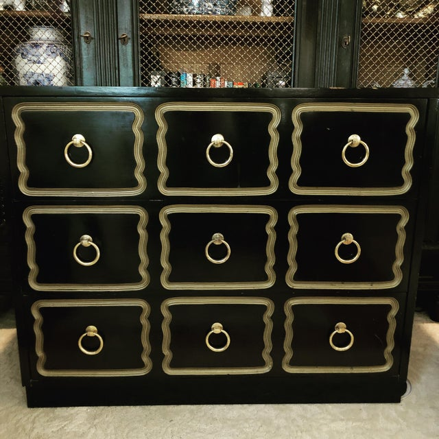 Dorothy Draper Espana style chest. This chest features three drawers with brass tone handled rings and inset panels in...