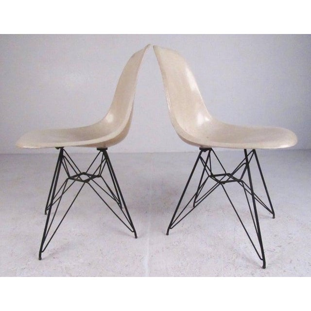 This iconic pair of Mid-Century Modern side chairs feature the Classic Charles Eames Eiffel Tower base and molded...