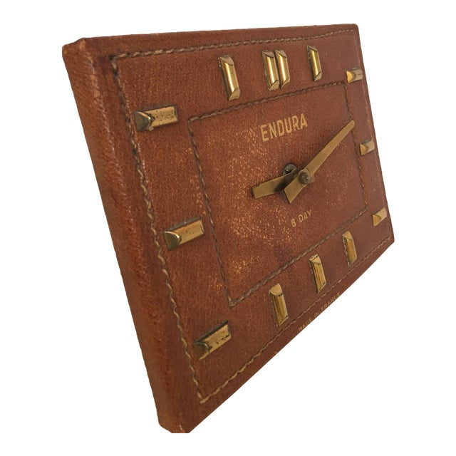 French leather Bauhaus desk clock in the style of Jacques Adnet. Hand stitched French leather desk clock with brass accent...