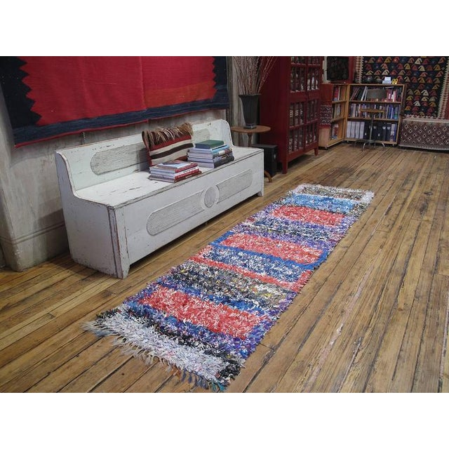 A Moroccan rag rug, woven in rare runner format, entirely with cut-up pieces of fabric from old clothes, etc. -...