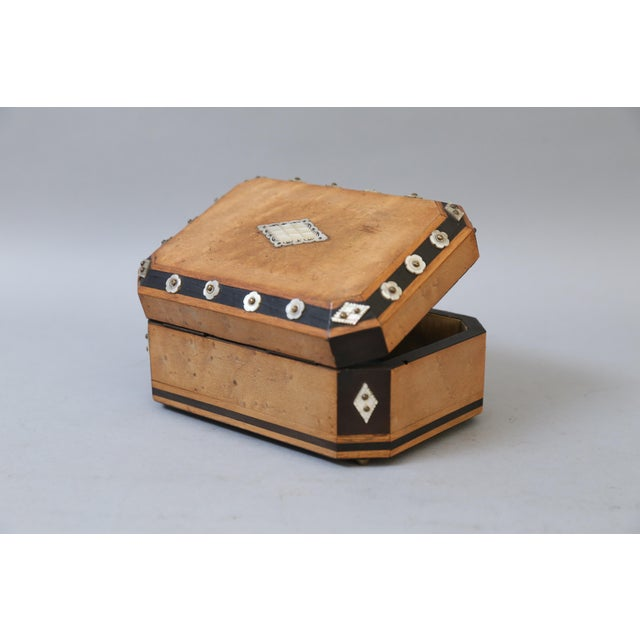 A fine early 20th-Century French satin wood, ebony and mother of pearl box. The box is embellished on all sides with the...